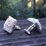 Photo of silver-plated carpet cuff links, side view