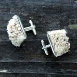 Photo of silver-plated carpet cuff links, top view