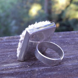 Photo of back of silver-plated carpet ring