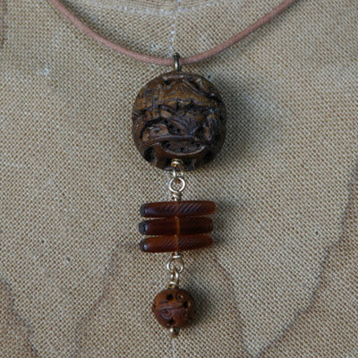 Horn and seed pendant on leather cord