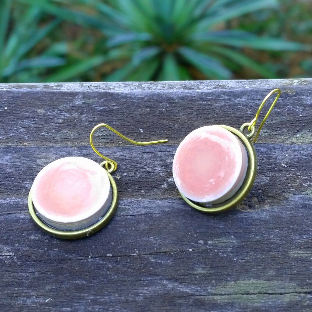 Photo of pink ceramic tile brass earrings