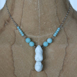 Antique porcelain doll necklace with aqua beads
