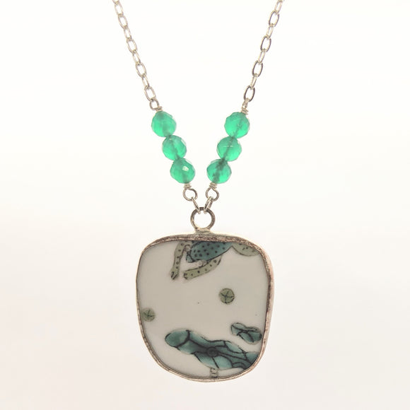Frog and lilypad pottery necklace with green faceted beads