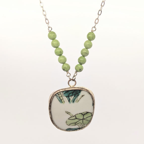 Lilypad pottery necklace with light green beads