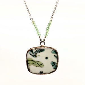Lilypad pottery necklace with green faceted stone beads