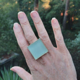 Photo of aqua glass tile silver-plated adjustable ring on hand