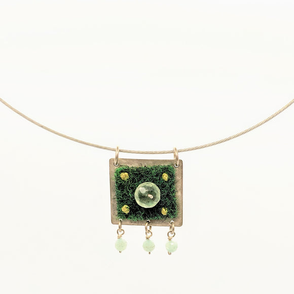 Green carpet and stone bead pendant on steel cable