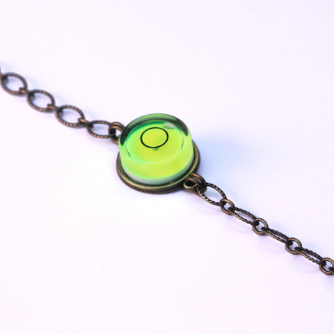 Large bullseye level bracelet with brass chain