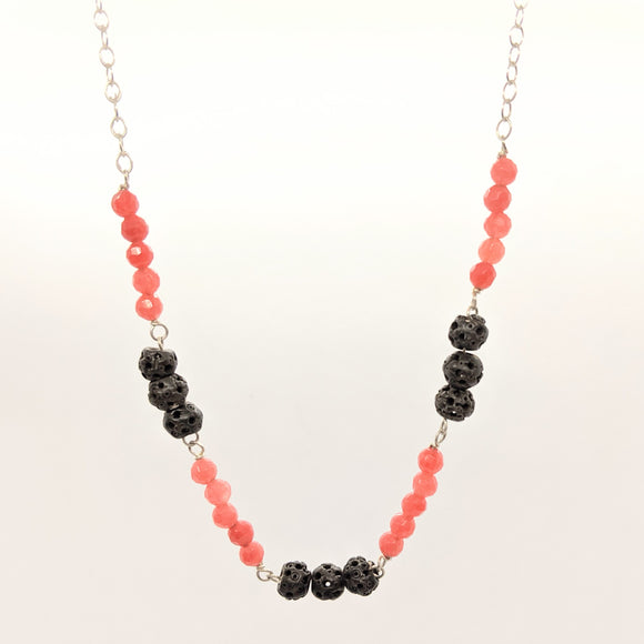 Carved bead and pink faceted stone necklace