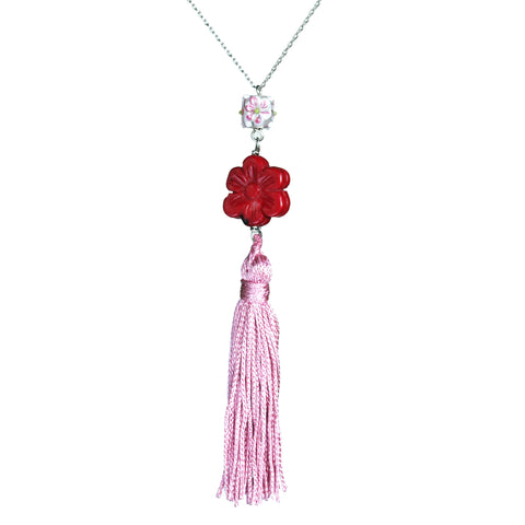Carved stone flower bead, glass flower bead, and pink vintage tassel necklace on steel chain