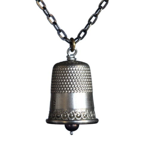Salvaged thimble pendant on brass patina chain