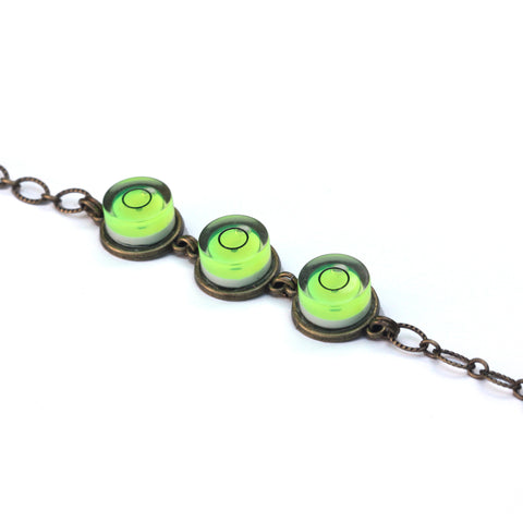 Triple bullseye level bracelet with brass chain