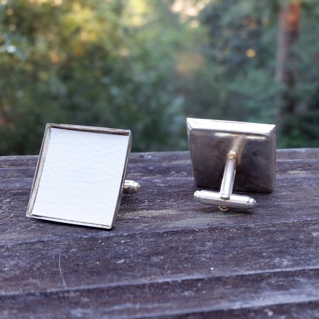 Photo of off-white silver-plated faux-leather upholstery cuff links