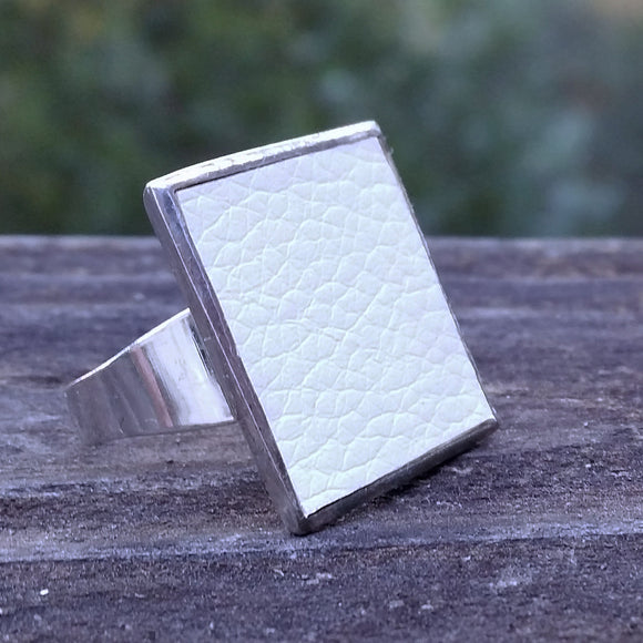 Photo of silver-plated upholstery ring, 3/4 view