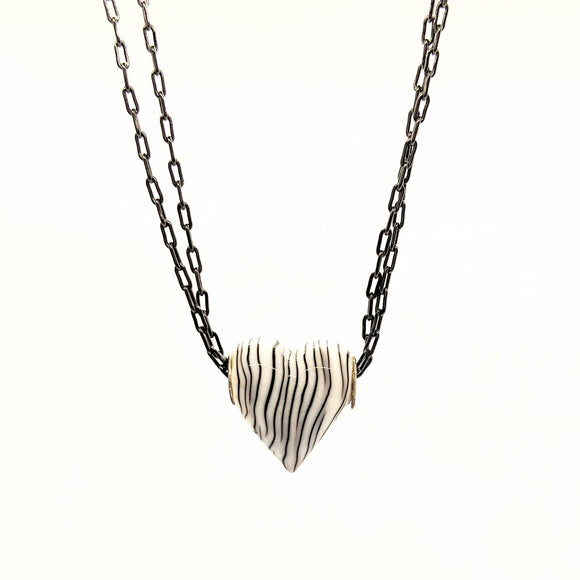 Zebra-striped heart necklace