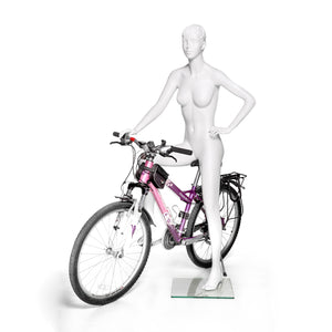 Athletic Female Mannequin Posing on Bicycle