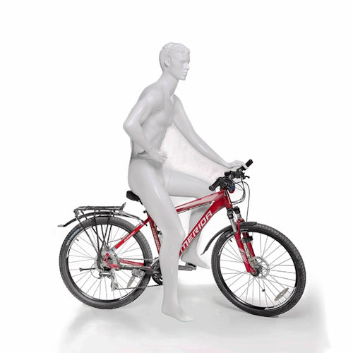 Athletic Male Mannequin Posing on Bicycle