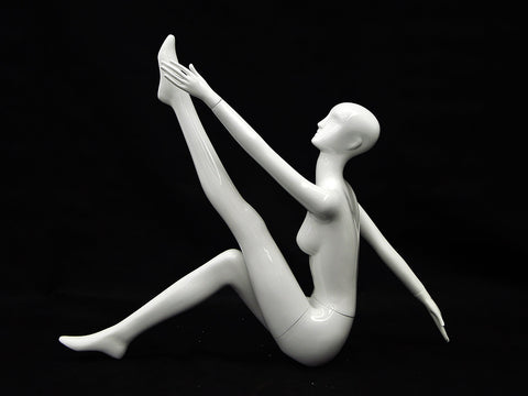 Abstract Face Female Mannequin in Stretching Pose