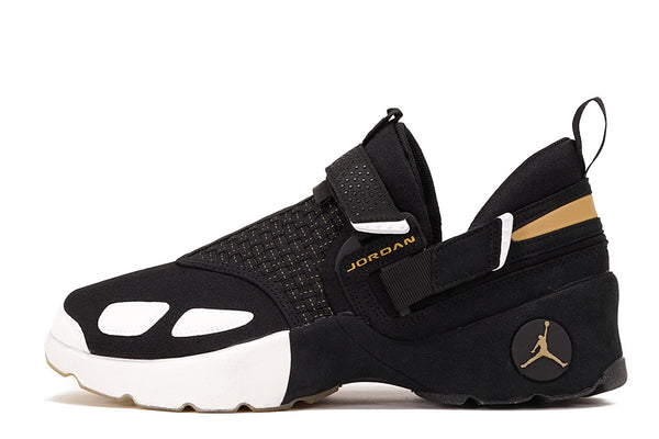 ee11574893b59c JORDAN TRUNNER LX BHM - BLACK   METALLIC GOLD
