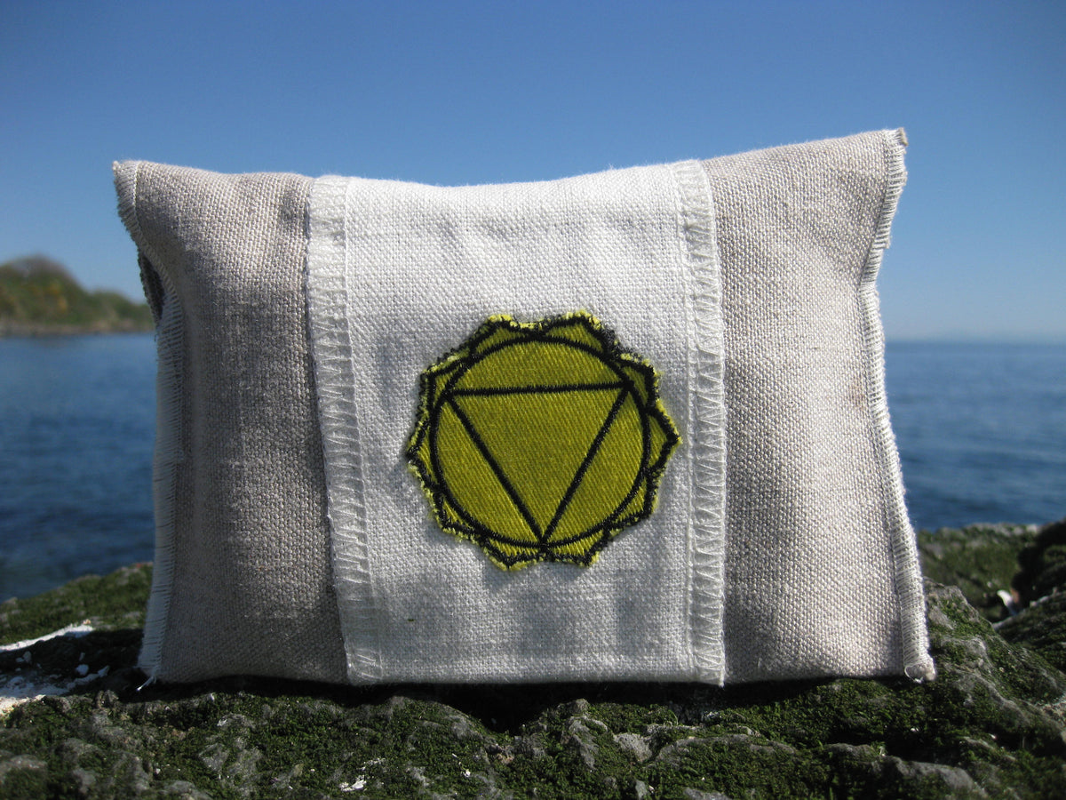 solar plexus chakra bag Chakra Balance Bags are composed of an outer hemp bag with an embroidered chakra coloured symbol. Inside are two smaller herbal pouches with blends of organic herbs and organic essential oils. These two pouches are stamped with chakra distinct coloured symbols for identity. Located within the hemp bag is a small drawstring bag containing 5 crystals. Three are chakra specific healing crystals, an extra crystal to continuously cleanse and clear the energies of the bag and a final cryst