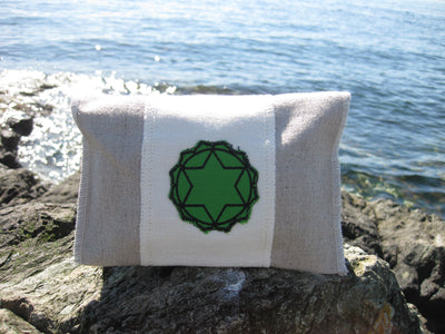 heart chakra Chakra Balance Bags are composed of an outer hemp bag with an embroidered chakra coloured symbol. Inside are two smaller herbal pouches with blends of organic herbs and organic essential oils. These two pouches are stamped with chakra distinct coloured symbols for identity. Located within the hemp bag is a small drawstring bag containing 5 crystals. Three are chakra specific healing crystals, an extra crystal to continuously cleanse and clear the energies of the bag and a final crystal to ampli