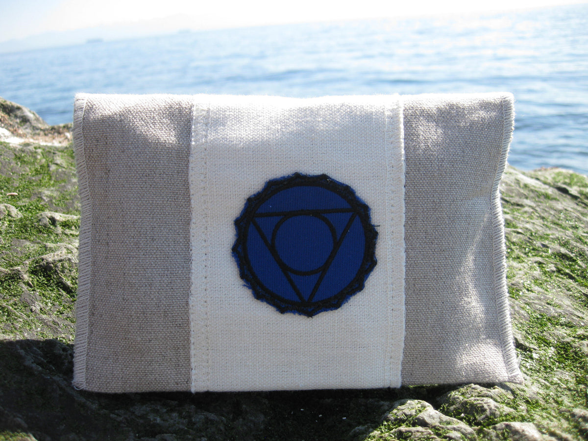 throat chakra Chakra Balance Bags are composed of an outer hemp bag with an embroidered chakra coloured symbol. Inside are two smaller herbal pouches with blends of organic herbs and organic essential oils. These two pouches are stamped with chakra distinct coloured symbols for identity. Located within the hemp bag is a small drawstring bag containing 5 crystals. Three are chakra specific healing crystals, an extra crystal to continuously cleanse and clear the energies of the bag and a final crystal to ampl