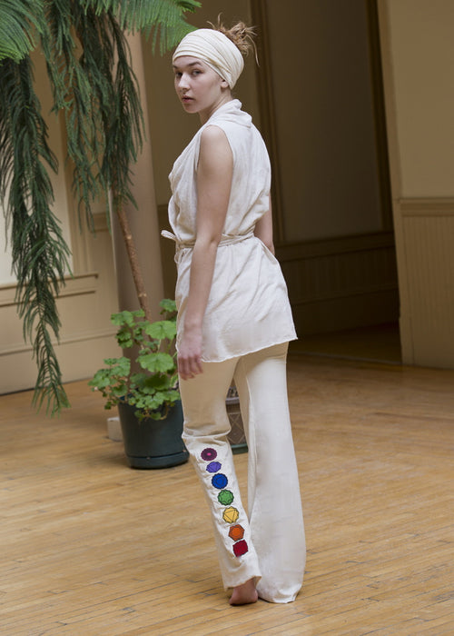 White hemp kundalini yoga pant with chakra patches appliquéd on leg made of hemp organic cotton stretch jersey or hemp organic cotton fleece with fold over waist band