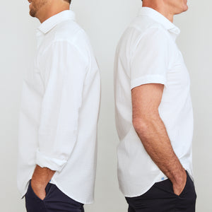 A solid look for a solid guy. THE white shirt you need this season. Seersucker, lightweight, and supremely cool. Available in short or long sleeve.  100% Cotton Seersucker • Spread Collar • Long Sleeve • Chest Pocket • Machine Washable • Made in Italy