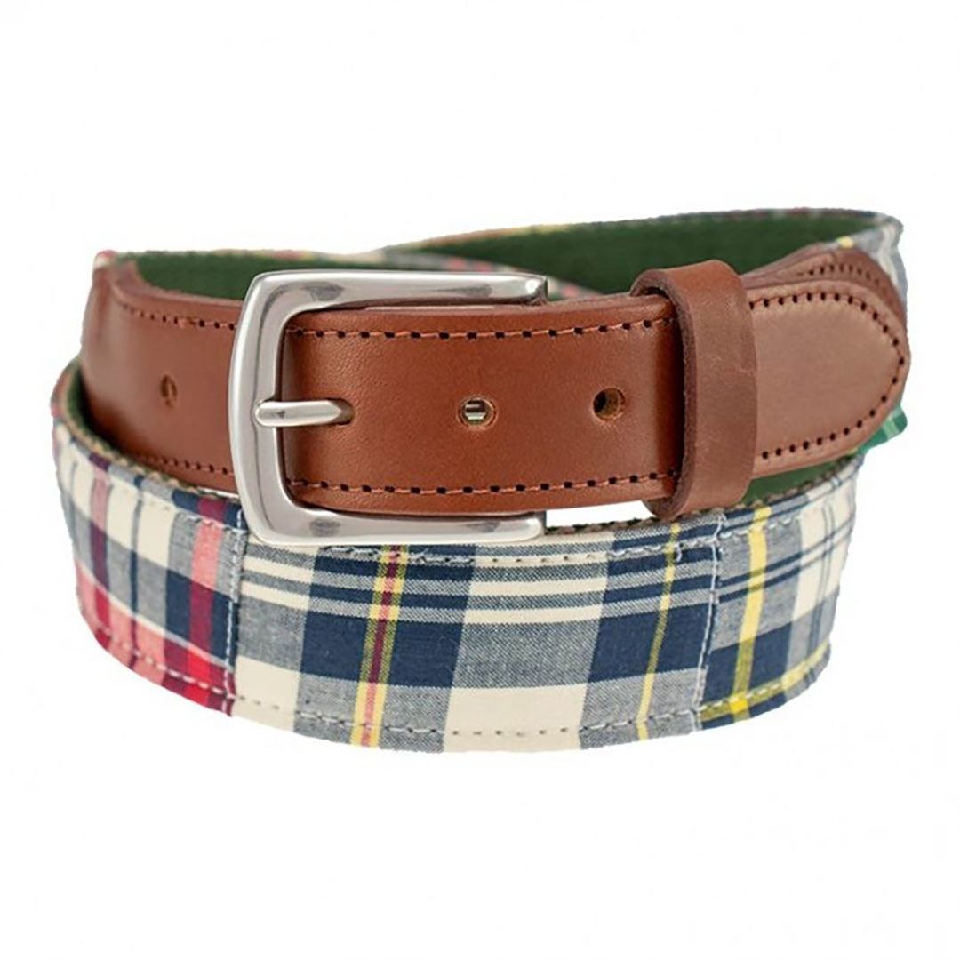 Our Haspel x T.B. Phelps collaboration belt is a stylish addition to any summer wardrobe, features genuine madras fabric in vivid summer colors. Perfect for your summer trip to the Vineyard or the Islands! The madras is backed on sturdy nylon webbing, finished with a sturdy briar tab set and nickel finish buckle.