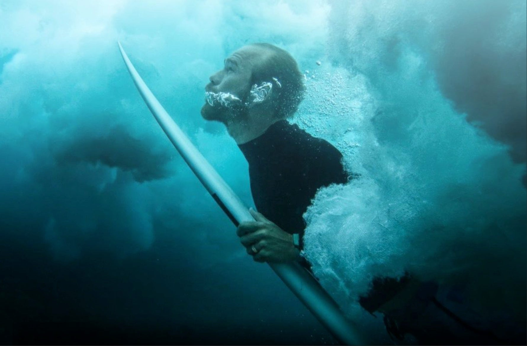 Man surfing wearing a silicone ring