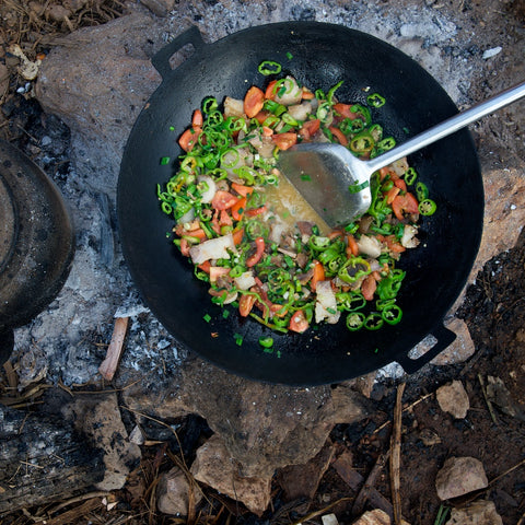 makeshift stove on dirt ground, and yes, those were spicy green peppers
