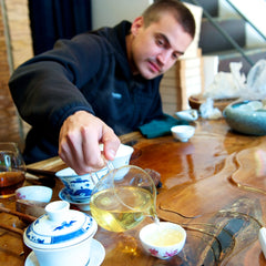 Ken learns the art of brewing Chinese  tea