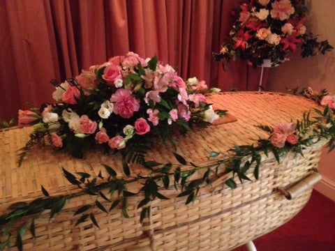The Eco funeral casket spray with garlands
