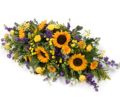 The sunflower casket spray