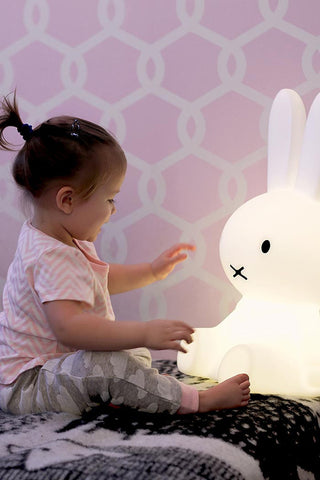 Girl playing with kids Miffy lamp from lilspaces.com