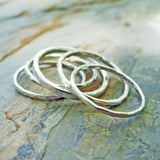 Set of 5 Sterling Silver Stacking Rings in Mixed Widths - Five Plain Hammered Silver Bands