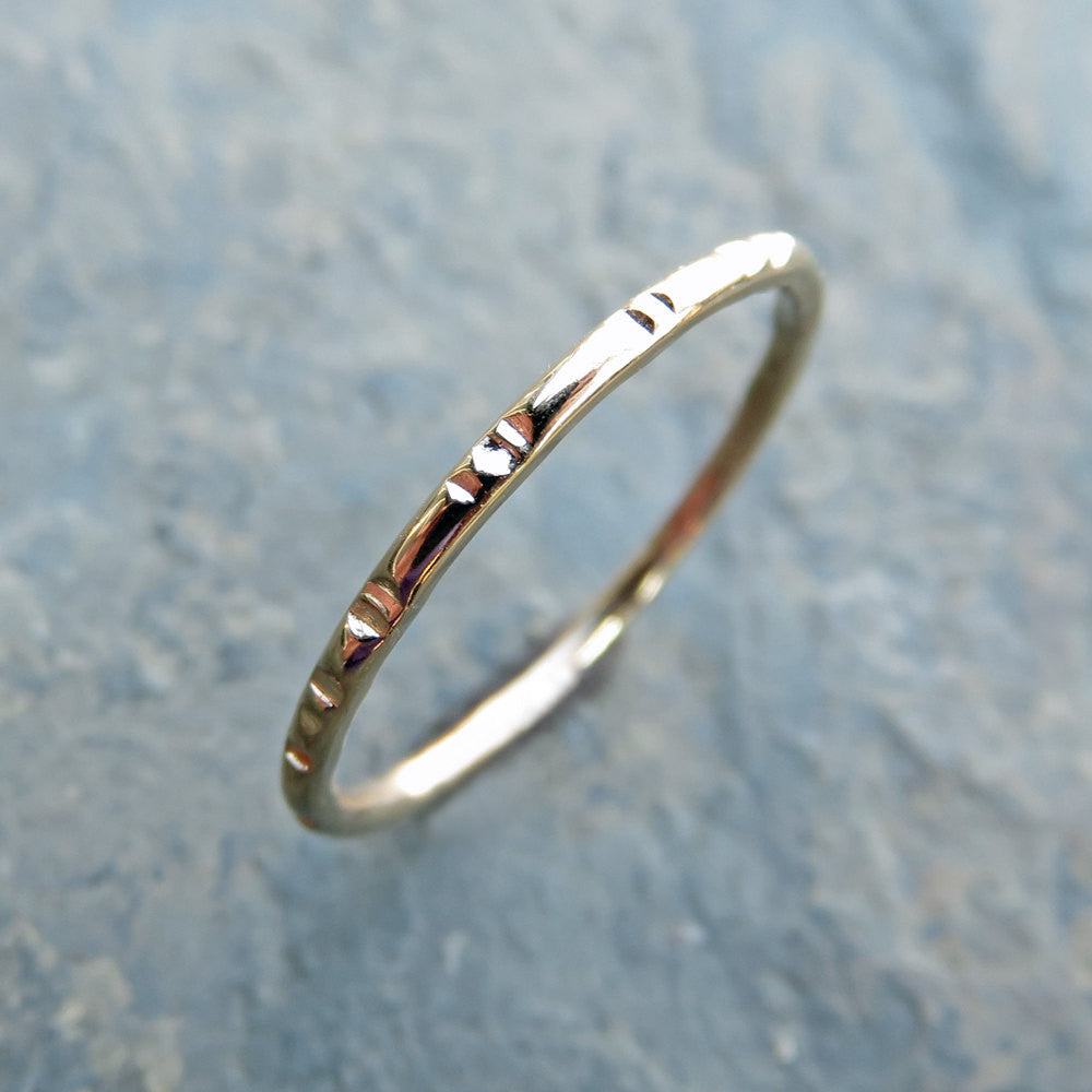 Notched 14k gold wedding band