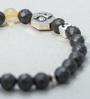 bracelet, faceted hematite, golden rutilated quartz - detail