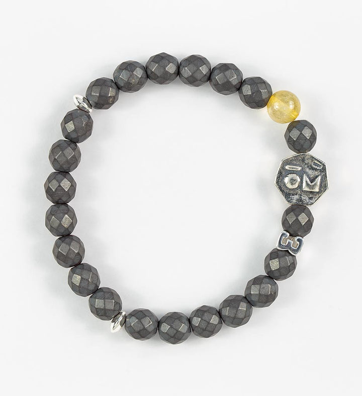bracelet, faceted hematite, golden rutilated quartz