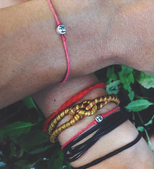 Modern Om Red String Bracelet Worn By Model