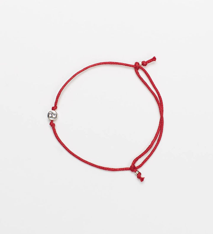 Modern Om Red String Bracelet Laydown