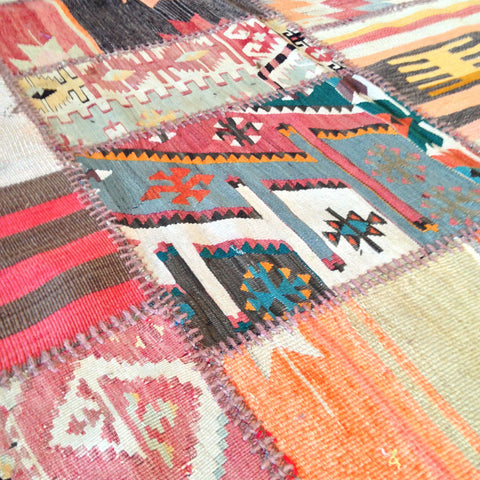 vintage flatweave rugs cut into squares and pieced together in a patchwork.