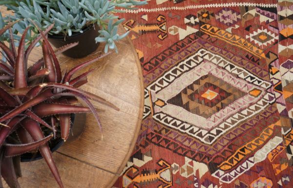 http://www.floorplanrugs.com/products/vintage-anatolian-kilim-with-five-layered-medallions-52-x-14