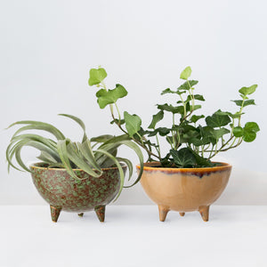 Two handcrafted three leg stoneware plant pots