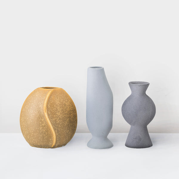 Set of three small glazed stoneware vases