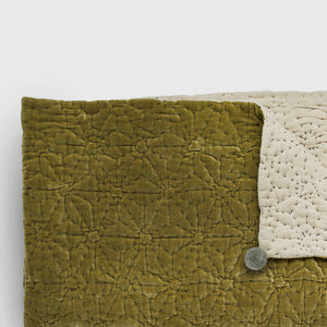 Handmade olive velvet quilted bedspread with grey pompoms