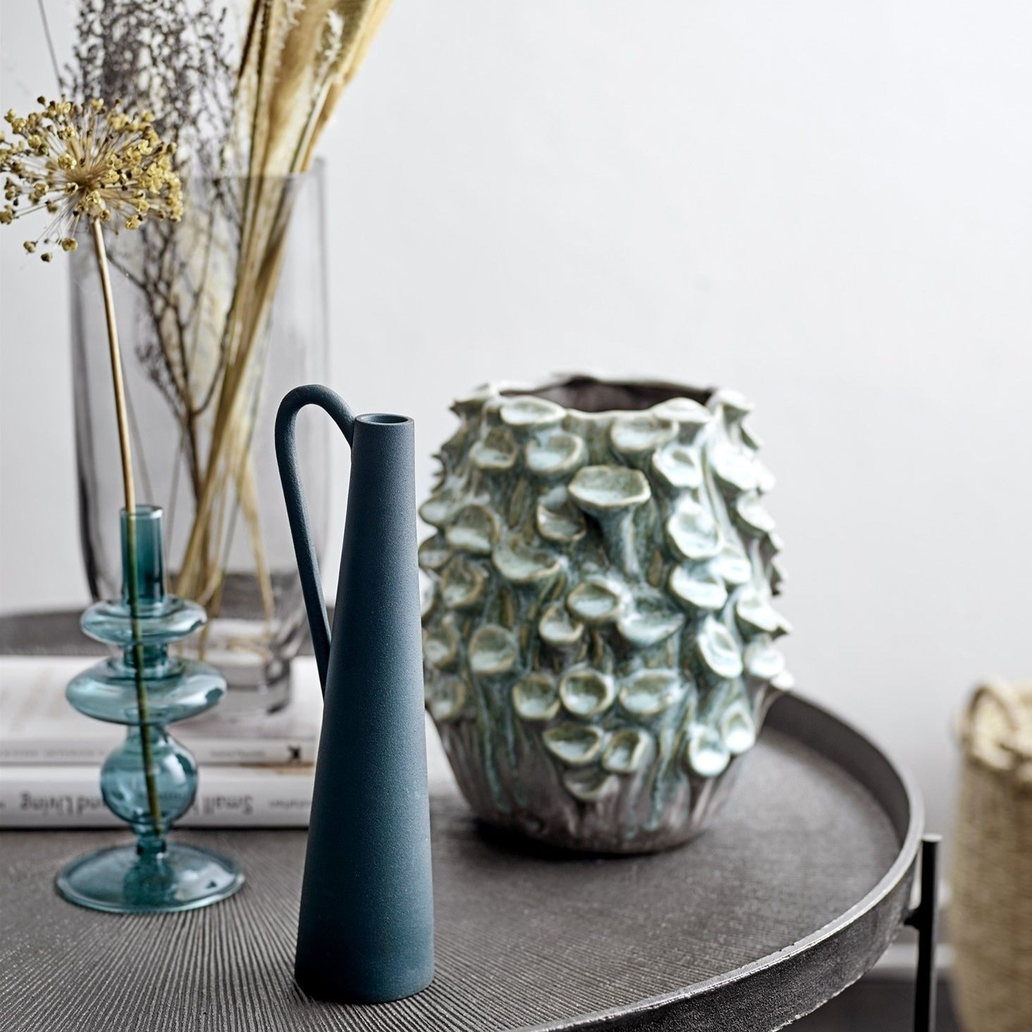 Tall teal metal vase