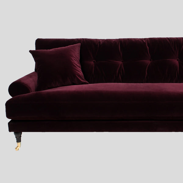 Ruby red velvet sofa