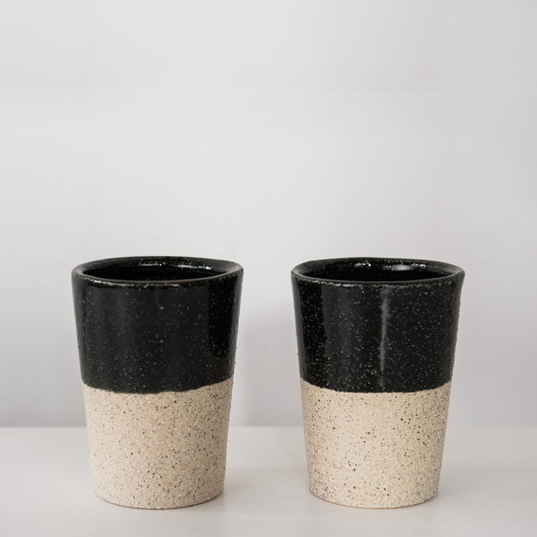 Black glazed stoneware coffee cup