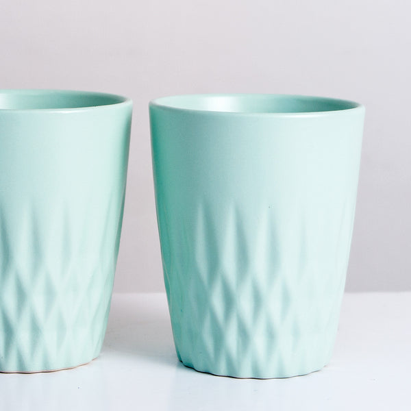 Two pastel mint cups, nordic design